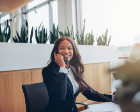 smiling-african-american-businesswoman-talking-on-XHFN6FA-scaled-277x221 AB Innovation Consulting - Your Legal-Tech Partner